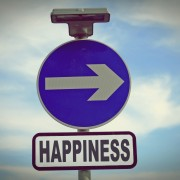 Blue sign points the way to happiness