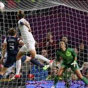 Canada's Sinclair scores a second goal past USA's O'Hara in the women's semi final soccer match against at the London 2012 Olympic Games at Old Trafford in Manchester